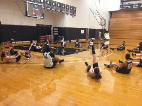 MAKING IT PERFECT: The women's basketball team warms up during a recent practice on campus. PHOTO BY JERMAINE DAVIS