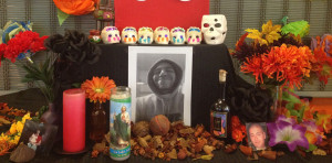 COMMEMORATION: The Puente Club placed a photo of deceased member Emmanuel Ruiz on a Dia de Los Muertos altar. PHOTO BY KARINA RAMIREZ