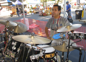 AT THE PUMPKIN FAIR: Robert Flores on the main stage getting  warmed up for the crowd early morning Saturday. PHOTO BY ORLANDO JOSE