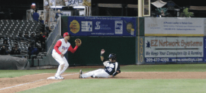 Infielder Nelson Muniz slides safely into third. PHOTO BY ZACARIAH MERCED-SPINDLER