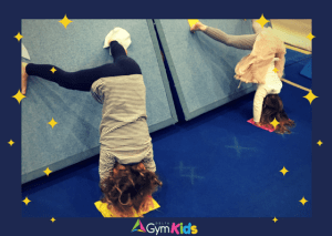 Kids gymnastics learning handstands - Delta Gymnastics Brisbane, Gold Coast & Barron Valley