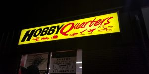Hobby Quarters Backlit Sign at Night