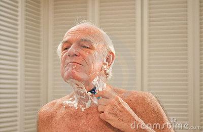 elderly-man-shaving-front-mirror-12134568