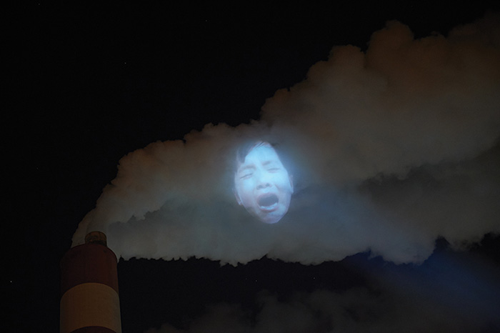 Children S Faces Projected On Factory Vapors To Protest