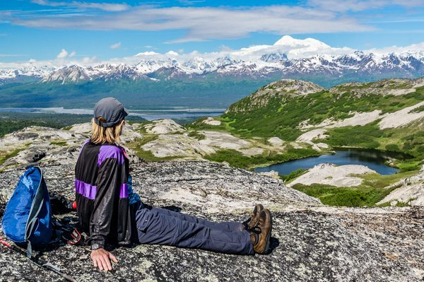 Denali State Park hiker with view of Mount McKinley.