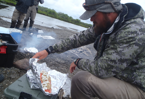 Cooking salmon over an open fire