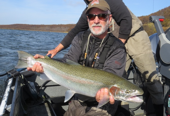 Fly fishing for huge Naknek rainbow trout at Rapids Camp Lodge
