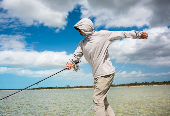 Grant Turner setting the hook on a bonefish by Bill Kalm
