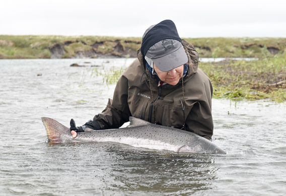Kathy Whiting with a big king salmon from Alaska West
