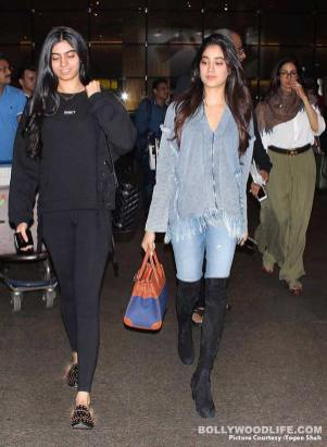 Actress daughter in denim jeans and long boot