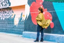 Women in Denim jeans near wall