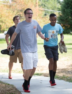 Davis Cameron '18, pictured above, among other participants walked a mile from the Granville Inn to Lamson Lodge wearing bright red high heels. Walk a Mile in Her Shoes raises awareness about sexual assault and violence against women.