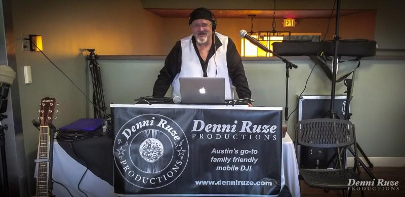DJ Moe posing in the DJ booth.
