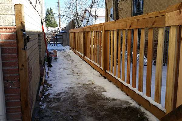 new fence in snow A Straight Up Fence Company Denver