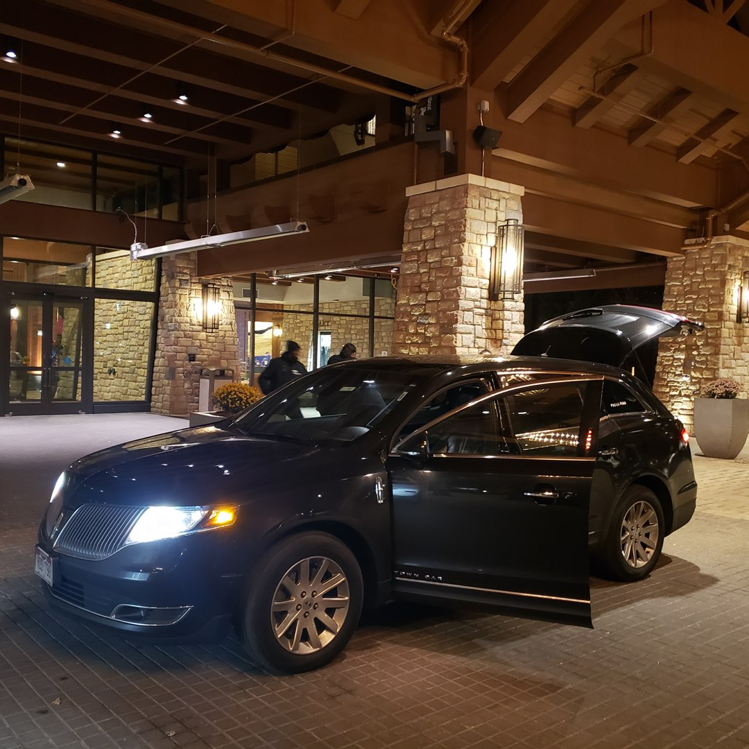 Luxury sedan at Gaylord Rockies Resort main entrance, drop off a ride from DIA