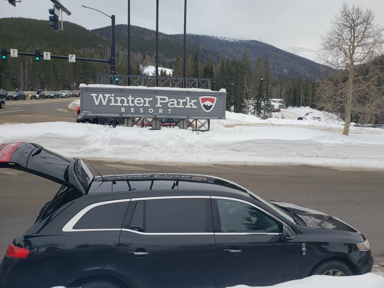 black Lincoln town car outside Winter Park Resort