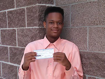 D'aris James Holding Scholarship Check