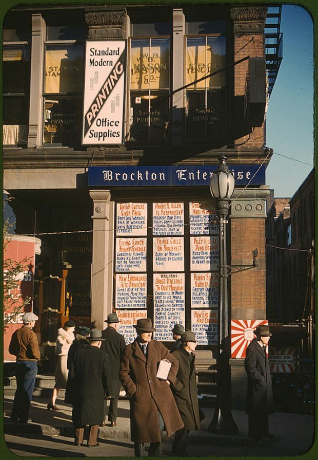 Headlines posted in street-corner window of newspaper office (Brockton Enterprise). Brockton, Massachusetts, December 1940. Reproduction from color slide. Prints and Photographs Division, Library of Congress