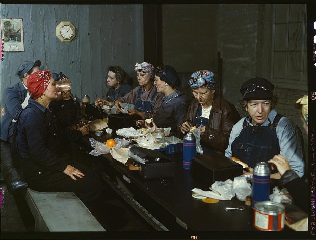 Women workers employed as wipers in the roundhouse having lunch in their rest room, Chicago and Northwest Railway Company. Clinton, Iowa, April 1943. Reproduction from color slide. Prints and Photographs Division, Library of Congress