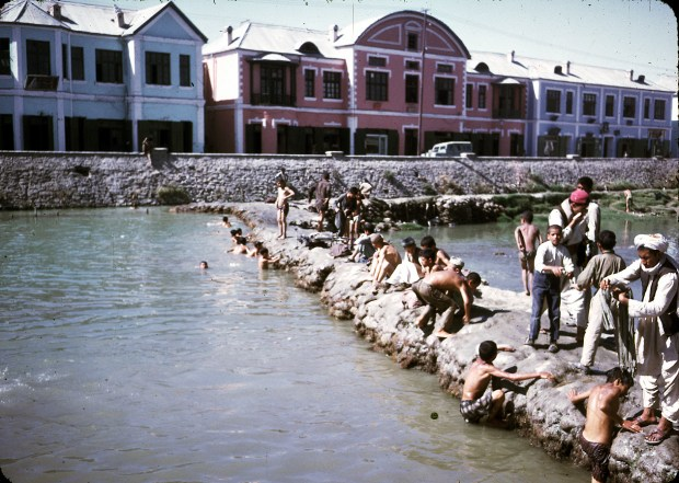 Men and boys washing and swimming in the Kabul River.