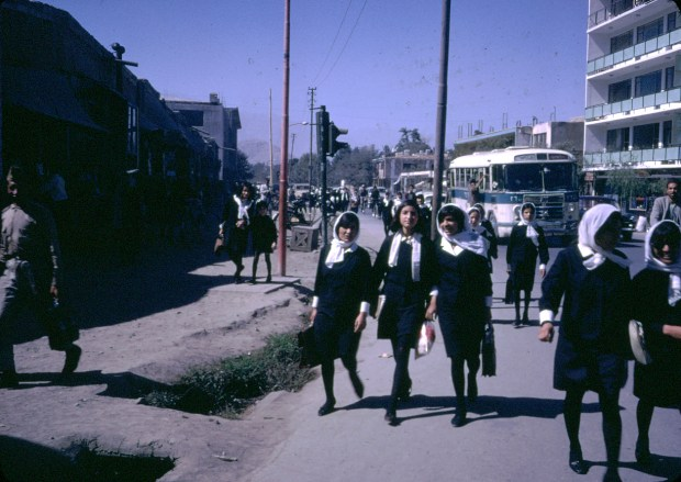"""Afghan girls coming home from school.""""Afghan girls, as well as boys, were educated up to the high school level, and although girls (and boys) wore uniforms, the girls were not allowed to wear a chadri on their way to secondary school. Able young women attended college, as did the men."""" - Peg Podlich"""