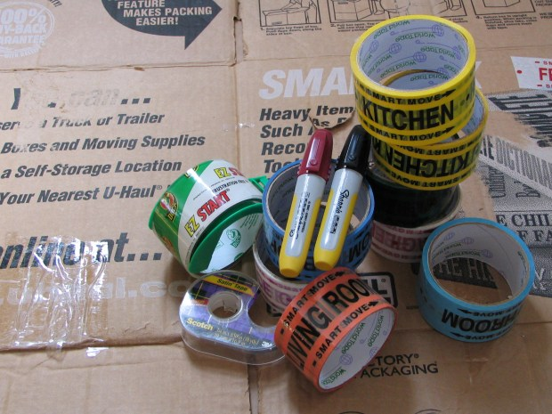 Moving boxes, markers and tape