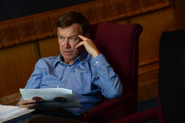 Governor John Hickenlooper is seen during a marijuana budget meeting in his office in between daily meetings in the state capitol in Denver on Sept. 10, 2014.