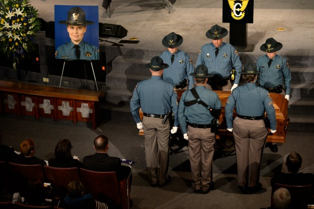 Members of the Colorado State Patrol attend to the casket of Colorado State Patrol Trooper Jaimie Jursevics during her funeral Nov. 15, 2015 at the Denver First Church of the Nazarene in Englewood.