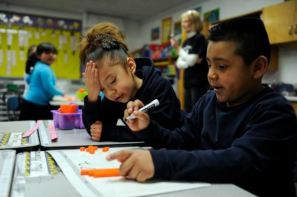 Aris Mocada-Orjas, left, and Abel Albarran work on a math problem at Hanson Elementary in Commerce City.