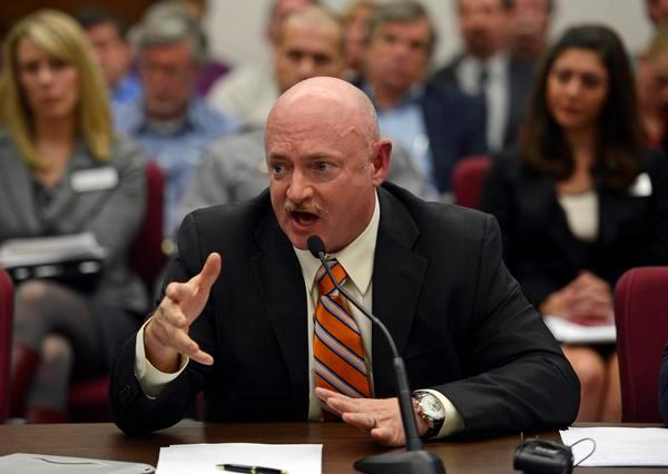 Mark Kelly, the husband of former U.S. Rep. Gabrielle Giffords, testified before Colorado lawmakers on a universal background check bill for private gun sales, March, 04, 2013, at the Colorado State Capitol.