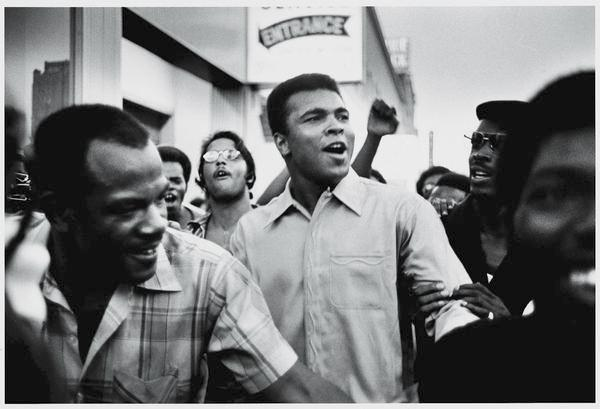 American heavyweight boxing champion Muhammad Ali walks through the streets with members of the Black Panther Party in New York in September 1970.