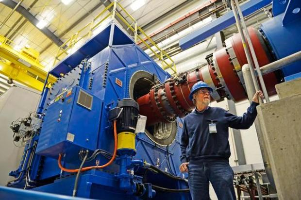 Mark McDade of the National Renewable Energy Laboratory shows off the new $16 million dynamometer in this 2014 file photo. The device is at NREL's National Wind Technology Center.