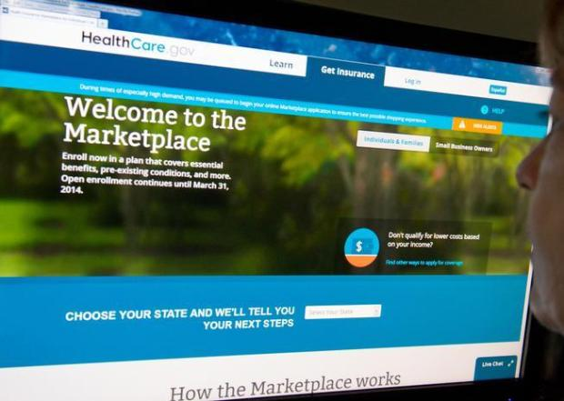 A woman reads the HealthCare.gov insurance marketplace internet site.