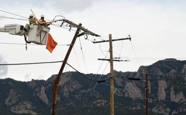 Utility crews for Xcel Energy work on fixing broken power lines due to strong winds in the Boulder area in this file photo. Voters are being asked once again whether to support a plan for Boulder to exit Xcel and start its own utility.