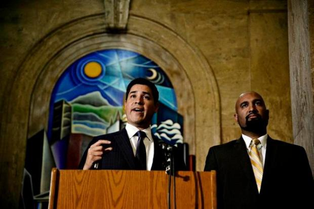 Denver City Attorney Scott Martinez, left, and Qusair Mohamedbhai, representing Jamal Hunter, hold a news conference in Denver in 2014 regarding a $3.25 million settlement in Hunter's federal jail-abuse lawsuit. (AAron Ontiveroz, The Denver Post)