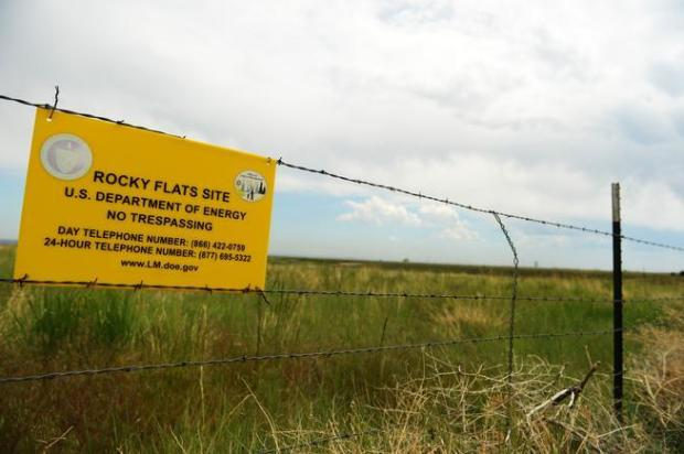 A sign hangs outside the grounds of the former Rocky Flats nuclear weapons production facility on May 29, 2014.