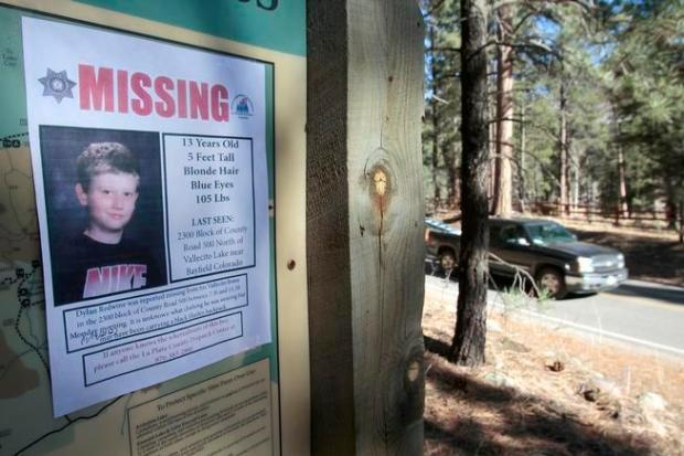 A November 2012 missing poster of 13-year-old Dylan Redwine hangs on a trailhead sign next to Vallecito Reservoir in Vallecito. Some of his remains were found in 2013.