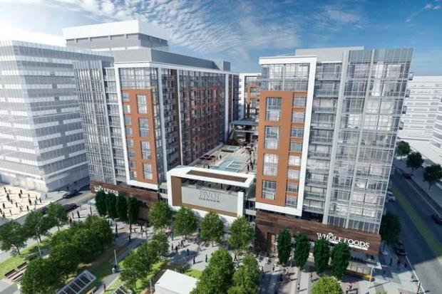 Pivot Denver, a 580-unit luxury apartment complex under construction near Union Station, will be anchored by downtown's first Whole Foods Market.