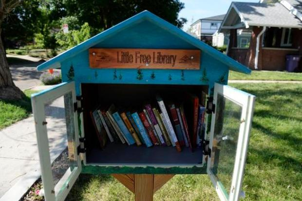 Cherry Street and East 26th Avenue: A handpainted library commemorates wildfires.