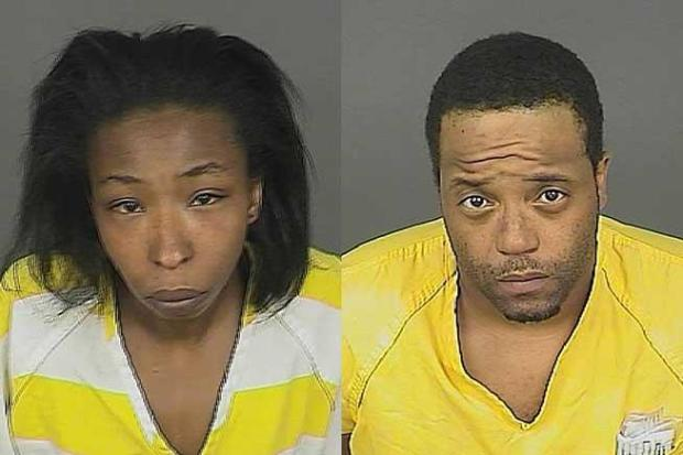 From left: Candice Lampley and Delonta Crank, Javion's mother and her boyfriend.