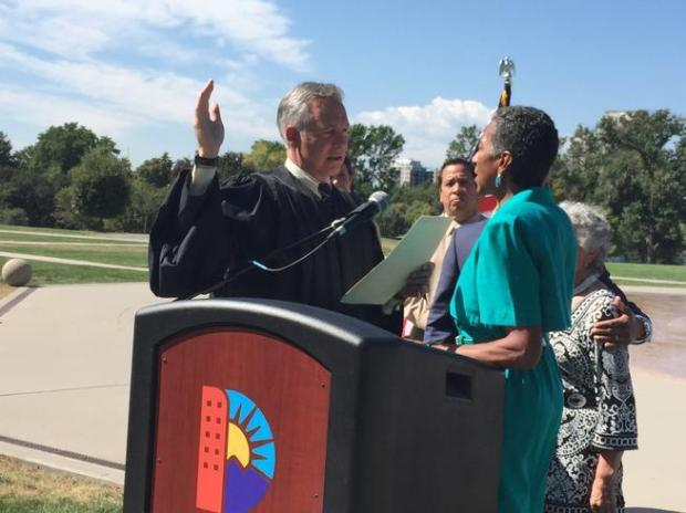 Happy Haynes, the executive director of the Denver Department of Parks and Recreation, takes the oath of office from Presiding Judge John Marcucci of Denver County Court at her appointment announcement on Sept. 8, 2015.
