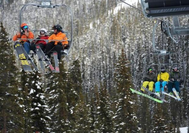 Skiers ride up the Lenawee Mountain lift at the Arapahoe Basin Ski Area.