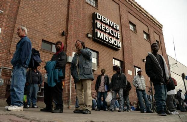 Homeless people line up at the Denver Rescue Mission on April 1, 2014.