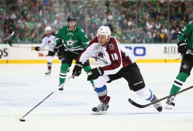 Shawn Matthias #18 of the Colorado Avalanche skates the puck against the Dallas Stars in the second period at American Airlines Center on April 7, 2016 in Dallas, Texas.