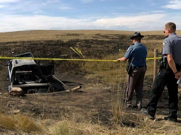 Two people are now facing murder charges - six months after two bodies were found inside a burned-out truck in Weld County.