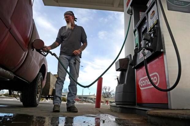 KERSEY, CO - JANUARY 25: Roger Beatch fills his truck up with gas at a gas station on January 25, 2016 in Kersey, Colorado. With oil prices now tumbling into the $20 range per barrel the impact on people that work in the industry has been big. Beach works in the oil and gas industry on the western slope of Colorado and said he would be busier if gas prices were not so low. (Photo by Helen H. Richardson/The Denver Post)