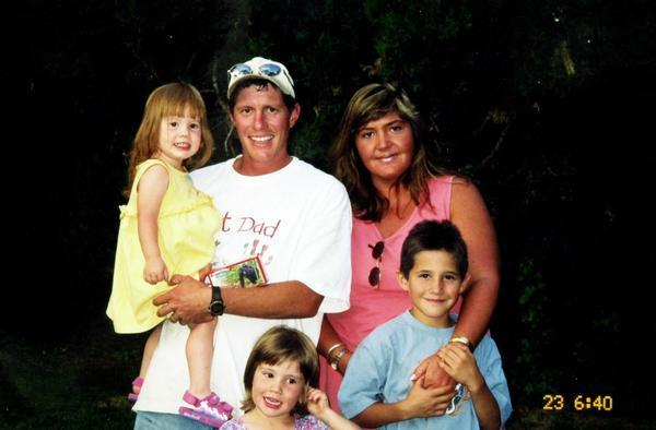 Timothy and Deborah Nicholls pose with their children, clockwise from left, Sierra, 3, Jay, 11, and Sophia, 5.