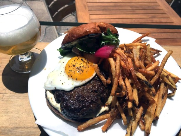 The Beastly Brunch Burger special is a Bison burger with pickled onion, tarragon aioli & sunny-side up farm egg, served with hand-cut fries and a house draft beer for $15. (Provided by Beast + Bottle)