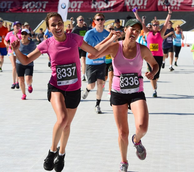 Katie Bernstein, left, and Laura Bernstein are happy to finish during the Citizens Race of the 2016 Bolder Boulder. For more photos and a video, go to www.dailycamera.com. Cliff Grassmick Staff Photographer May 30, 2016
