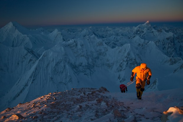 A rare winter sunrise warms Denis Urubko and Simone Moro (trailing) en route to the summit of PakistanÕs Gasherbrum II. For the past 26 years, 16 expeditions have tried and failed to climb one of Pakistan's 8,000 meter peaks in winter. On February 2, 2011, Simone Moro, Denis Urubko and Cory Richards became the first. Cory is now the only American to summit any 8,000 meter peak in winter. The journey nearly killed them. Cory carried a small camera and filmed the ordeal constantly. (Photo provided by Cory Richards Photography, LLC)